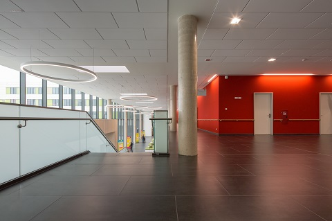 The large, light-filled foyer with reception and cafeteria