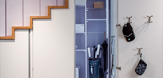 A shelf system divides up the walk-in wardrobe.