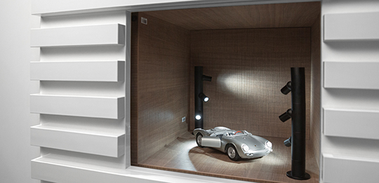 Illuminated niches are the platform for collector's items.