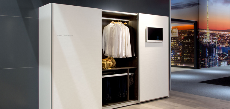 The illuminated wardrobe rails provide a good overview of the wardrobe.
