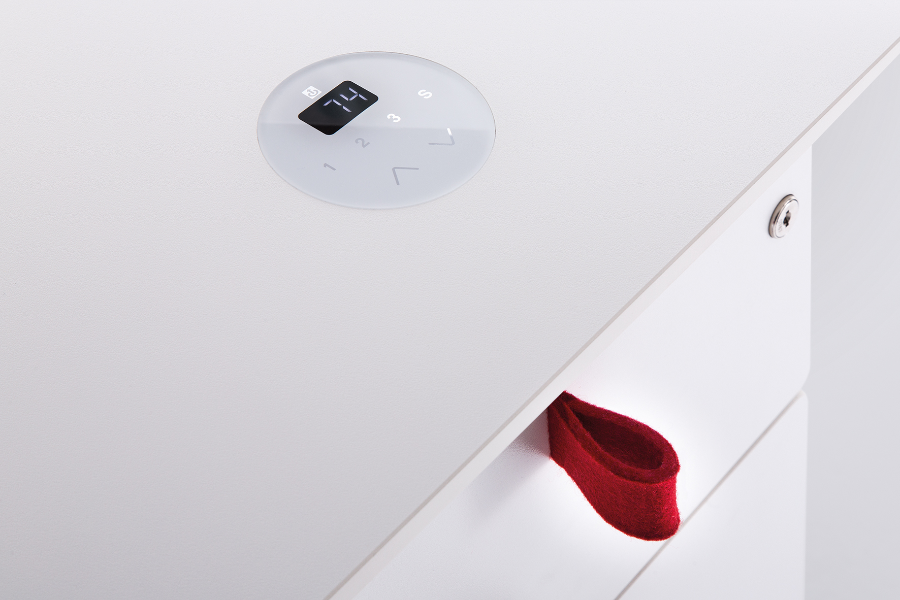 The control unit for height adjustment on Häfele's table base is integrated in the table top.