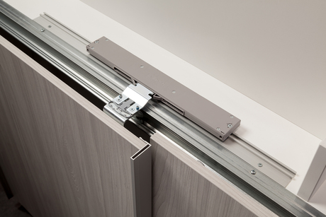 The innovative soft close mechanism for the middle door is simply attached to the cabinet top.