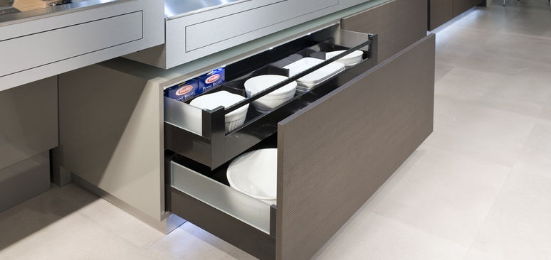 The kitchen drawers, which are over a metre wide, can be moved out of the base unit with a mere finger press.