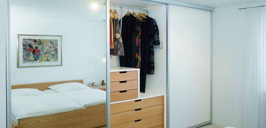 A wardrobe for utilising all available space.